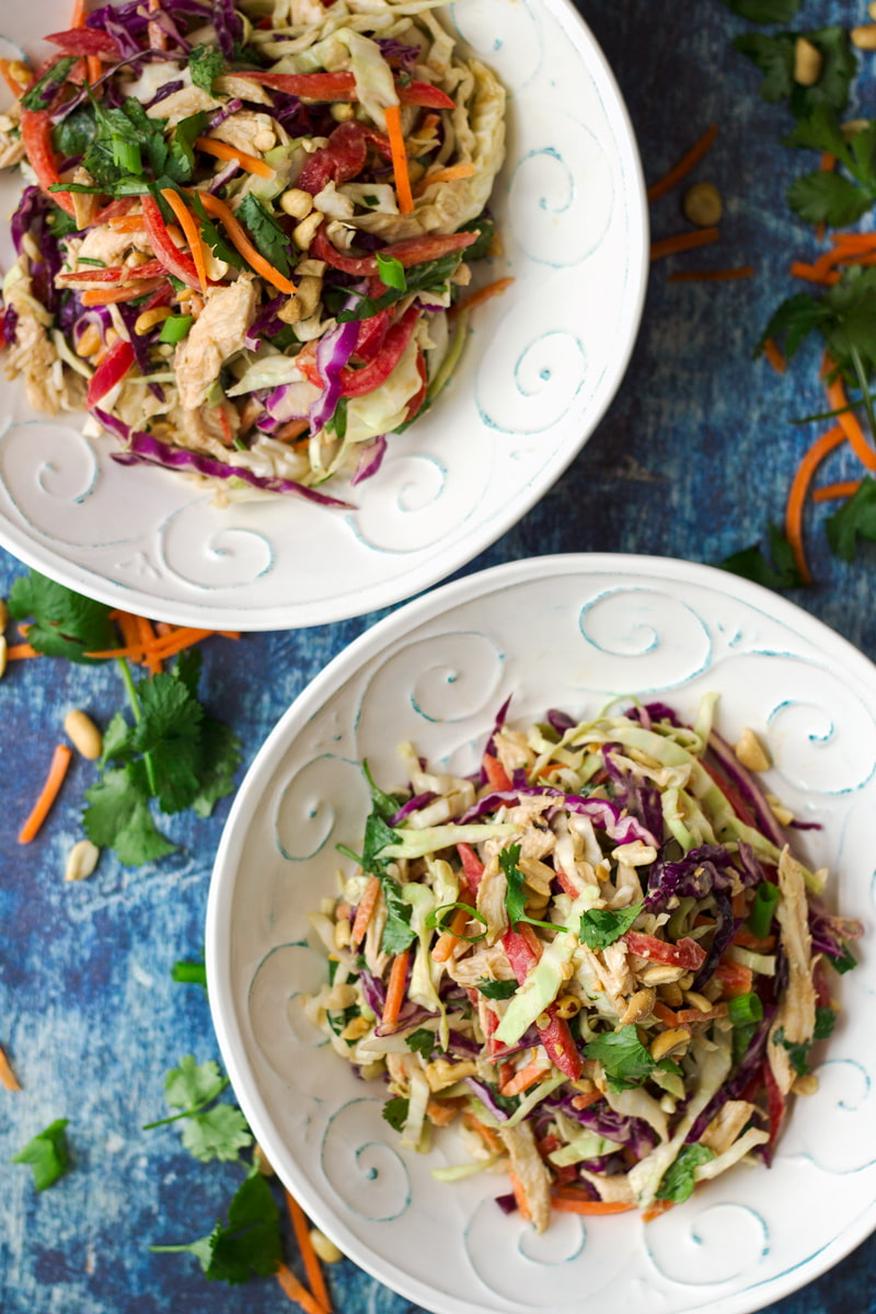 two bowls of asian chicken slaw salad