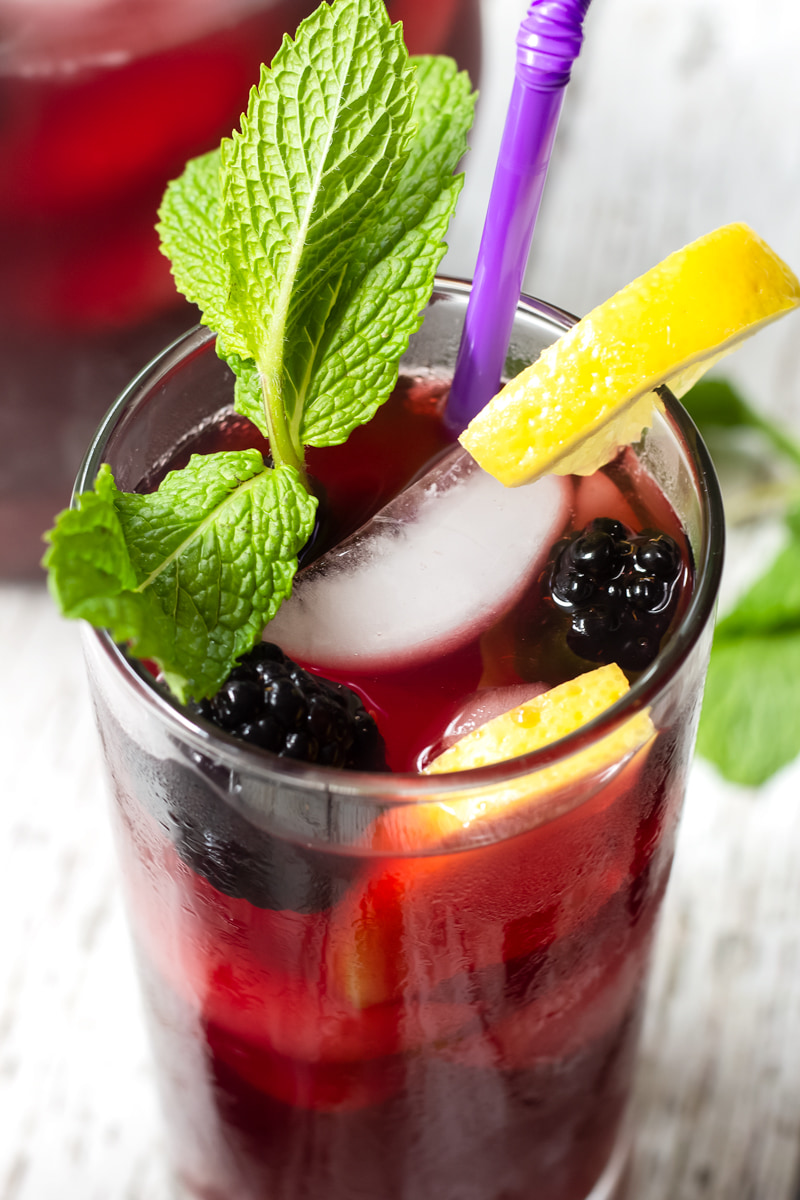 blackberry iced tea with mint and lemon garnish