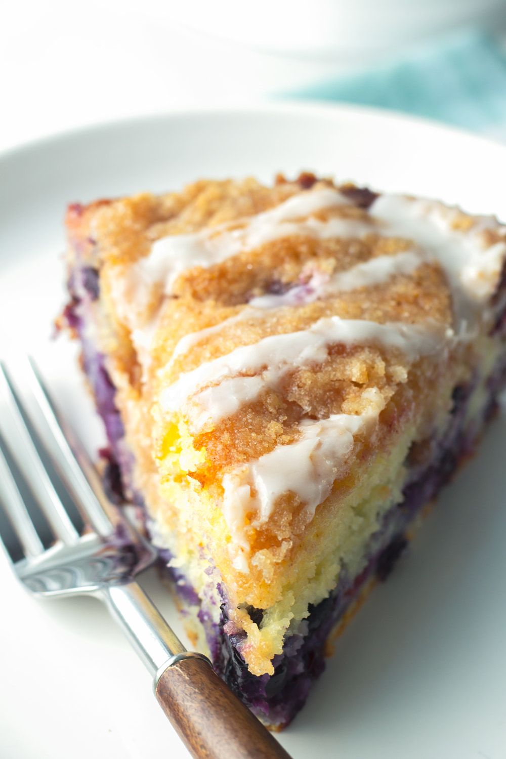 slice of blueberry coffee cake with lemon glaze