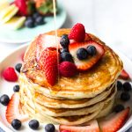 light and fluffy buttermilk pancakes with berries and maple syrup