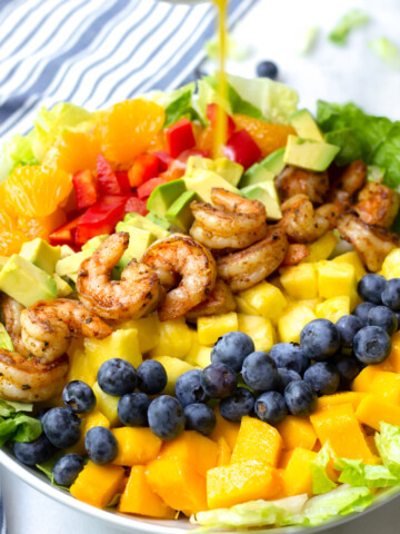 tropical shrimp salad drizzled with orange poppy seed dressing