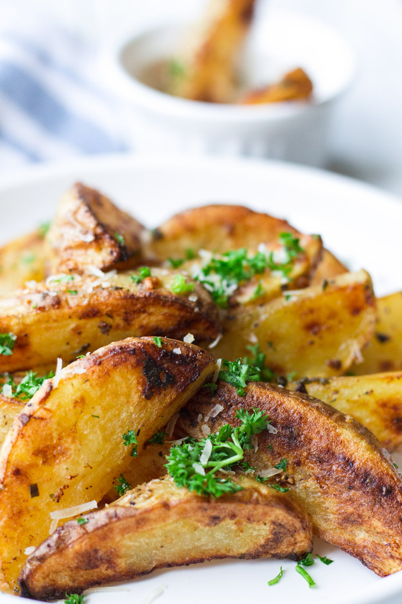 garlic roasted potato wedges with a sprinkle of parmesan
