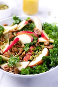 kale and apple salad with pecans and pumpkin seeds