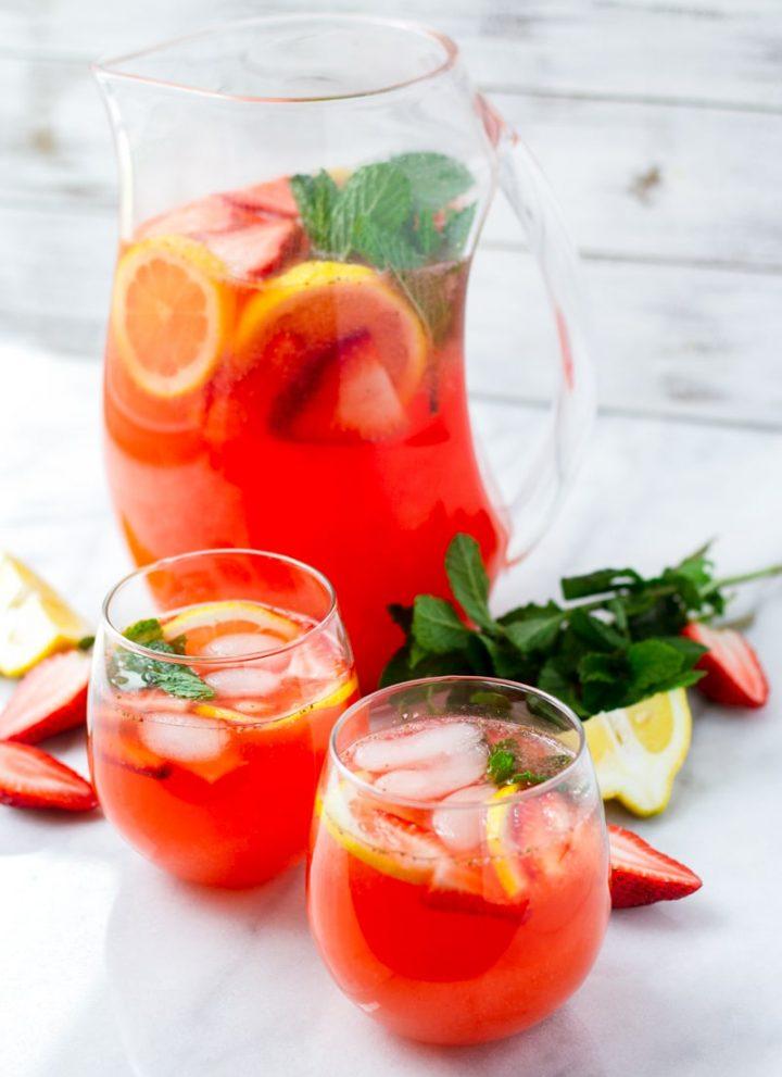 Two Glasses of Strawberry Lemonade with Lemon Slices