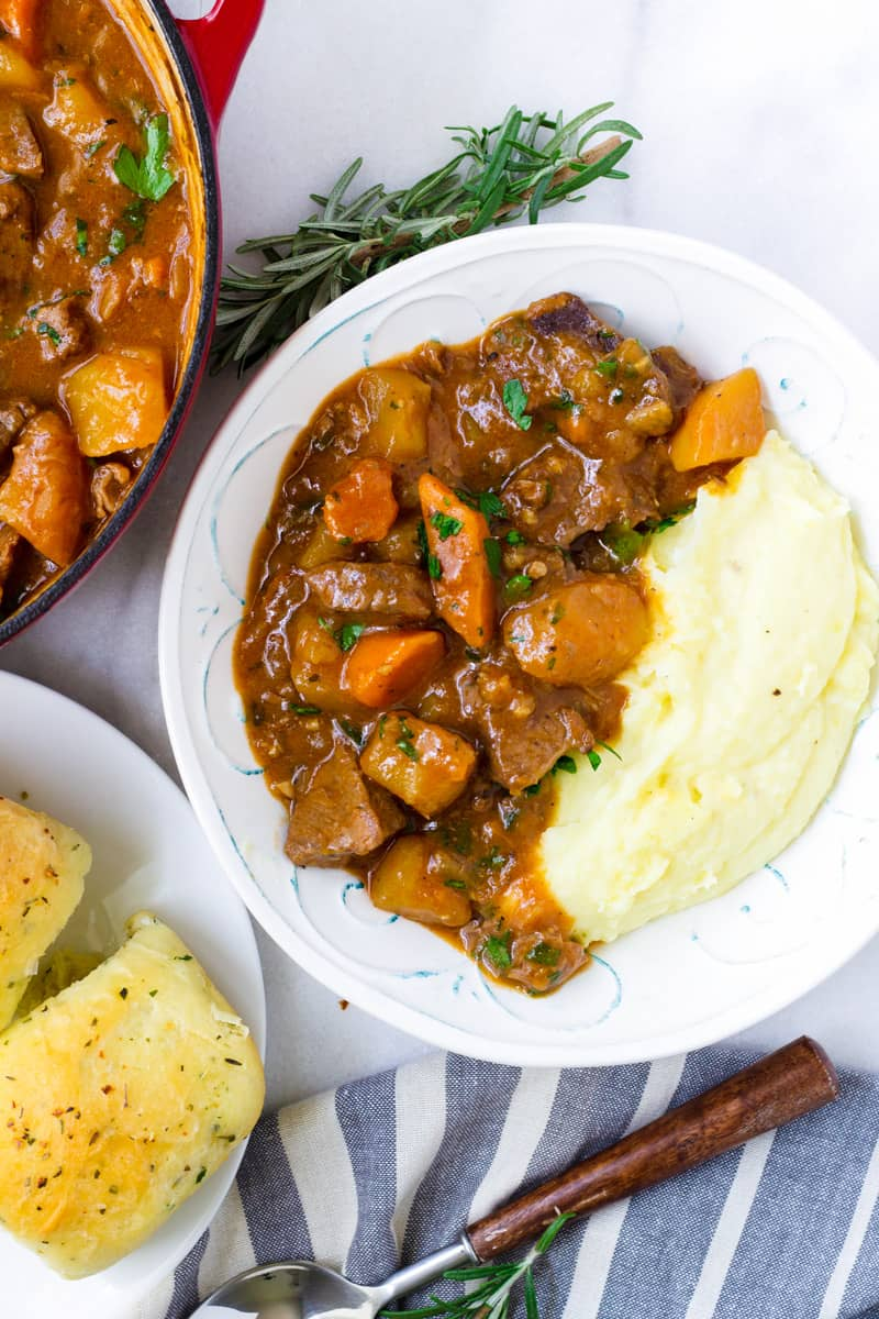 Hearty Beef Stew with Mashed Potatoes and Bread