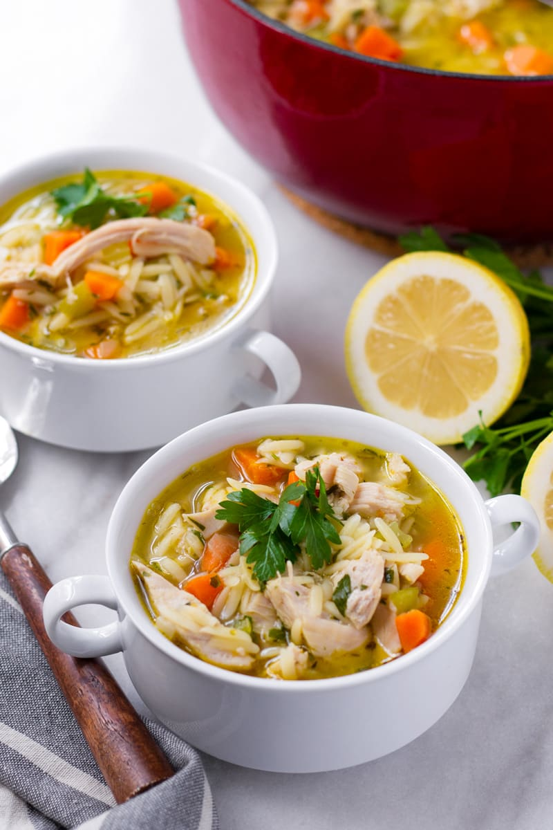 Two bowls of turkey orzo soup