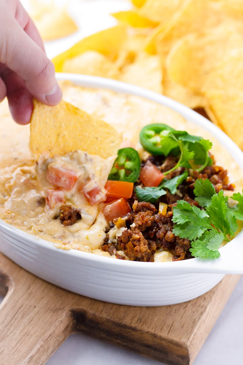 Dipping into a Serving Bowl with Smooth Queso Dip