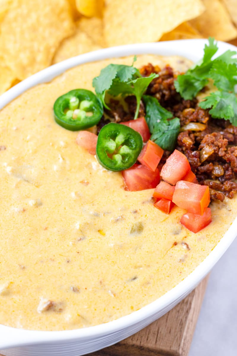 Close-up of Mexican Queso with Jalapenos, Diced Tomatoes, and Cilantro