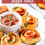 Ham and pepperoni pinwheels with marinara dipping sauce in the middle and parsley garnish