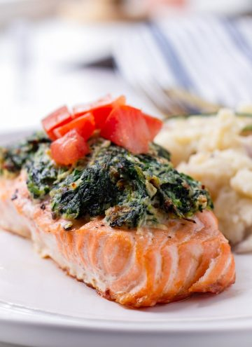 One Salmon Fillet with Spinach and Topped with Tomatoes