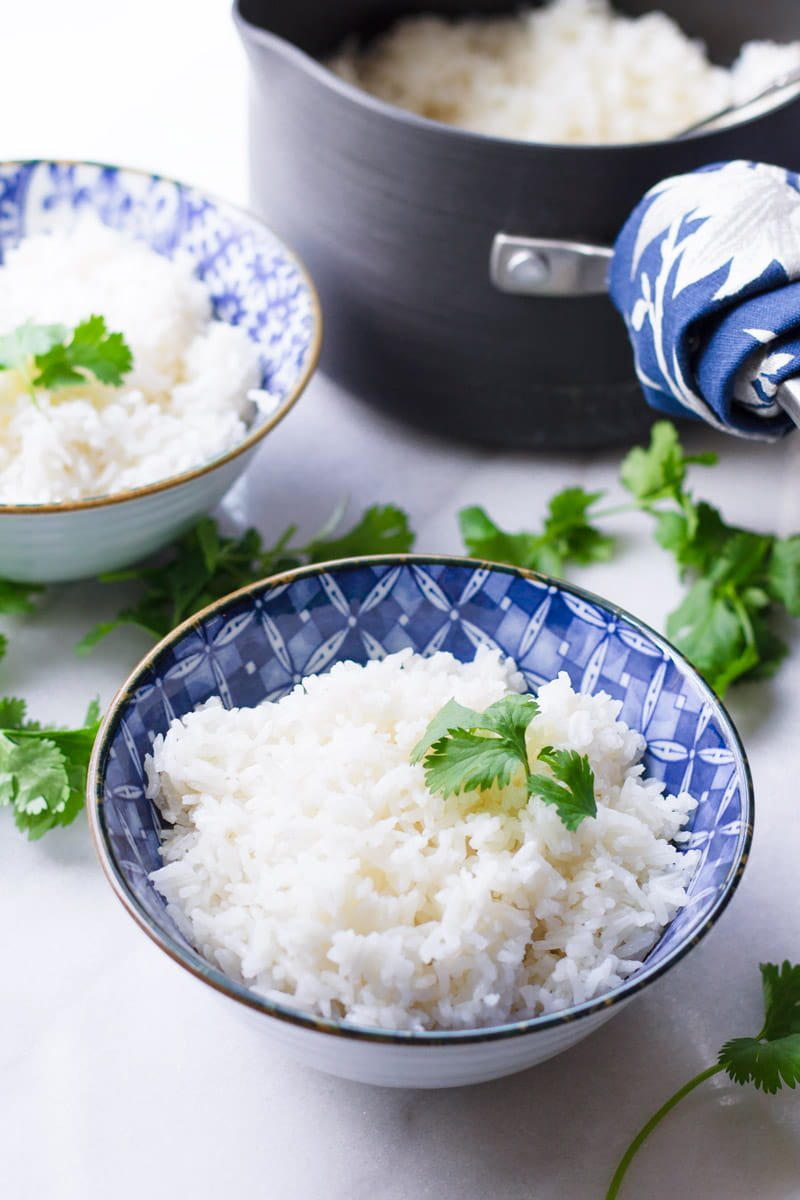 Two Blue Ceramic Bowls with Coconut Rice and Cilantro