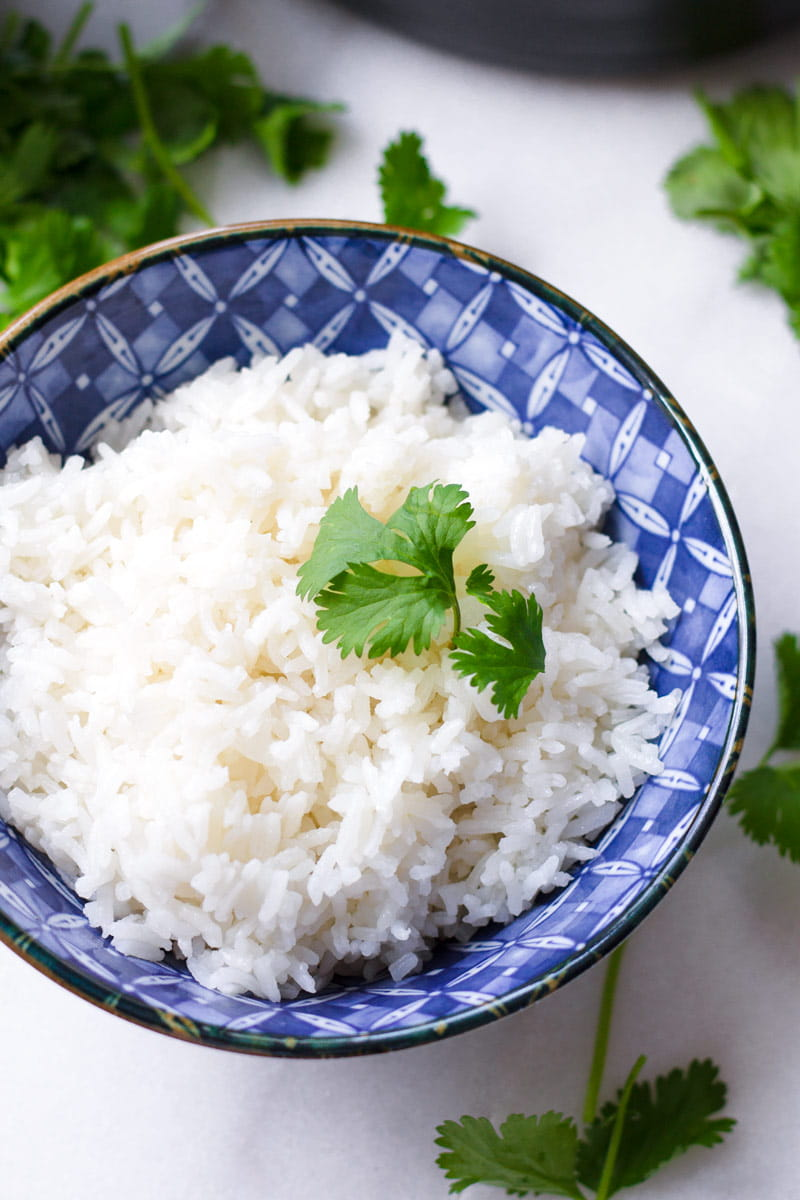 Close-up of an Asian-designed bowl with Coconut Rice Garnished with Cilantro