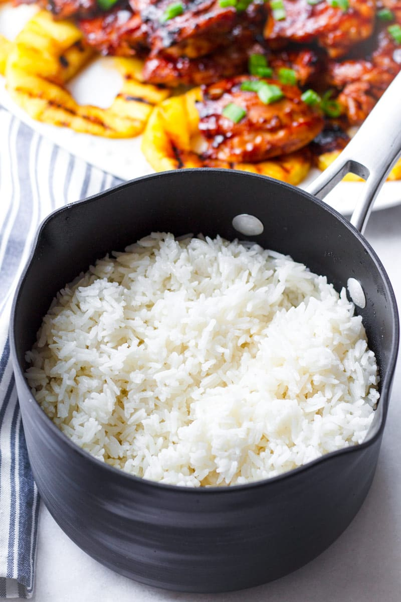 A medium pot of white rice with coconut milk