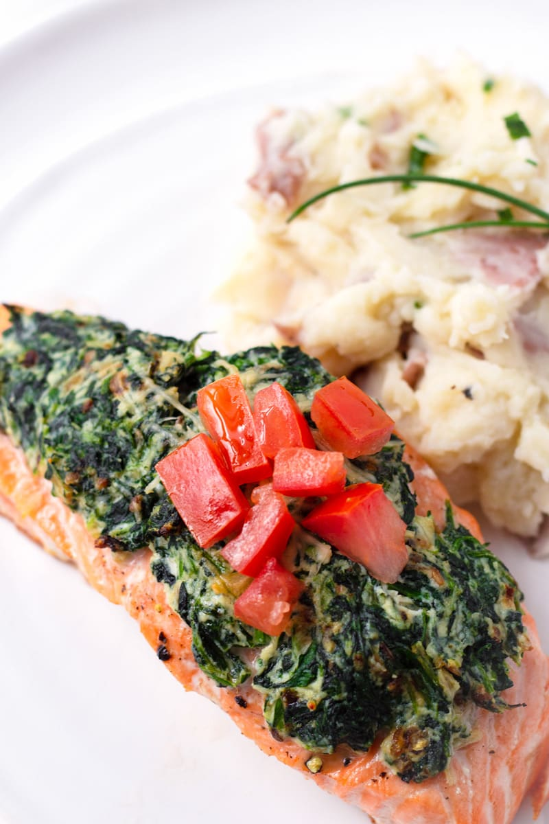 One Piece of Stuffed Salmon Florentine Style with a Side of Potatoes