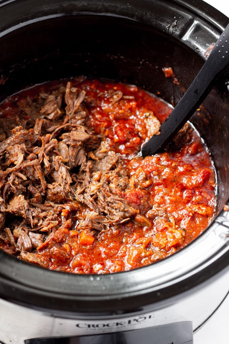 Meat in the slow cooker with tomato sauce