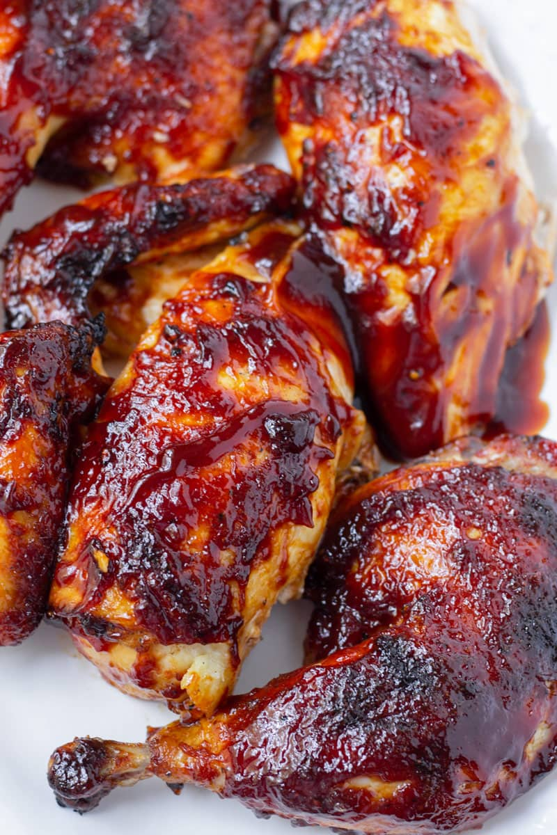 Cut up whole chicken pieces with barbecue sauce