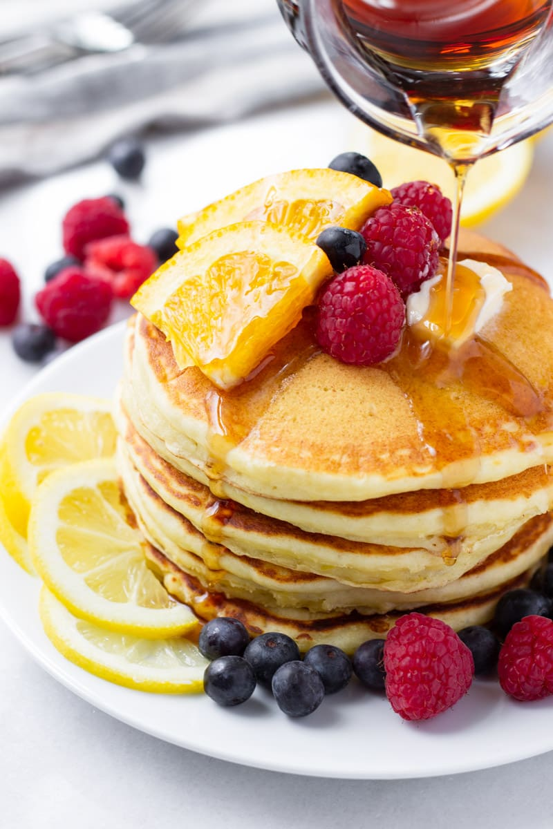 Lemon pancakes drizzled with maple syrup