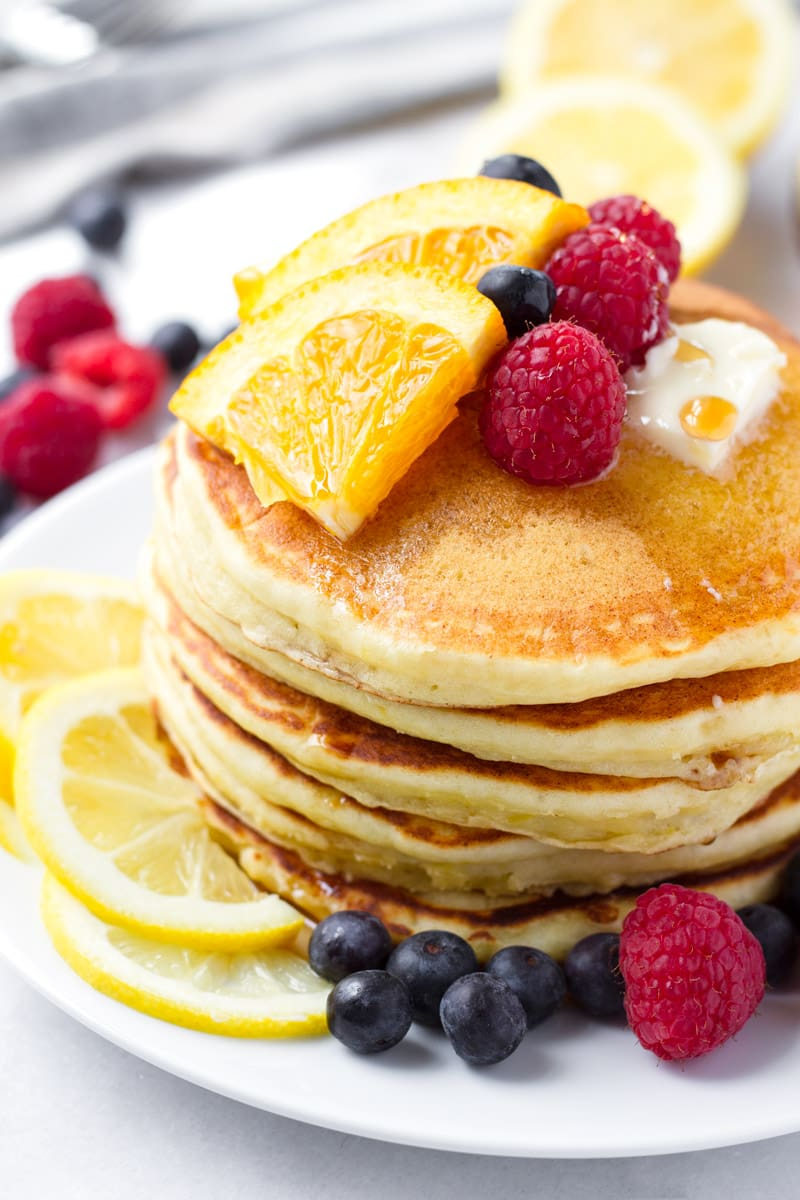 Stack of fluffy pancakes made with ricotta and lemon