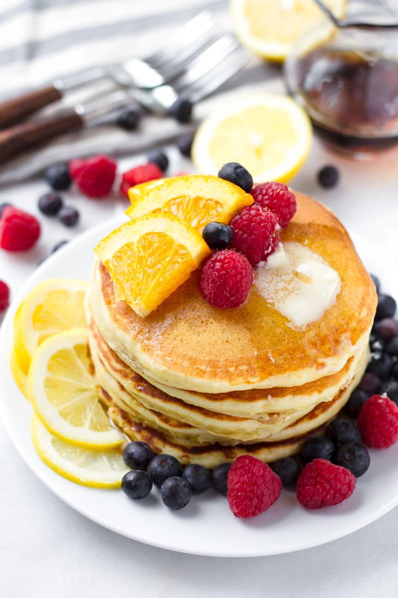 Lemon Ricotta Pancakes with Berries and Fresh Lemon Slices