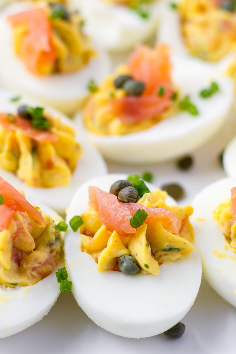Close up of deviled eggs with smoked salmon and capers