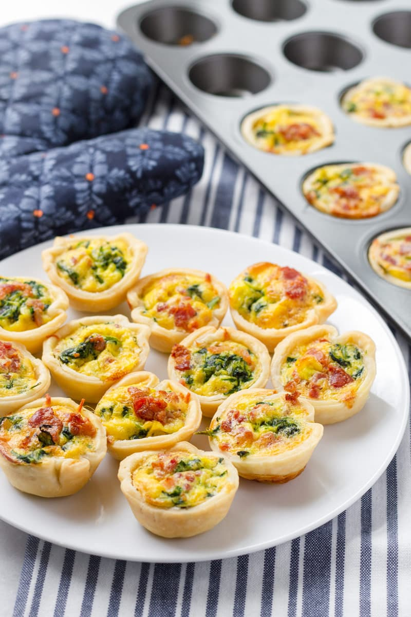 Plate with mini spinach quiche with oven mitt