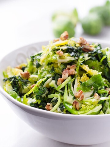 Bowl of Shaved Brussels Sprouts Salad with Walnuts and Kale