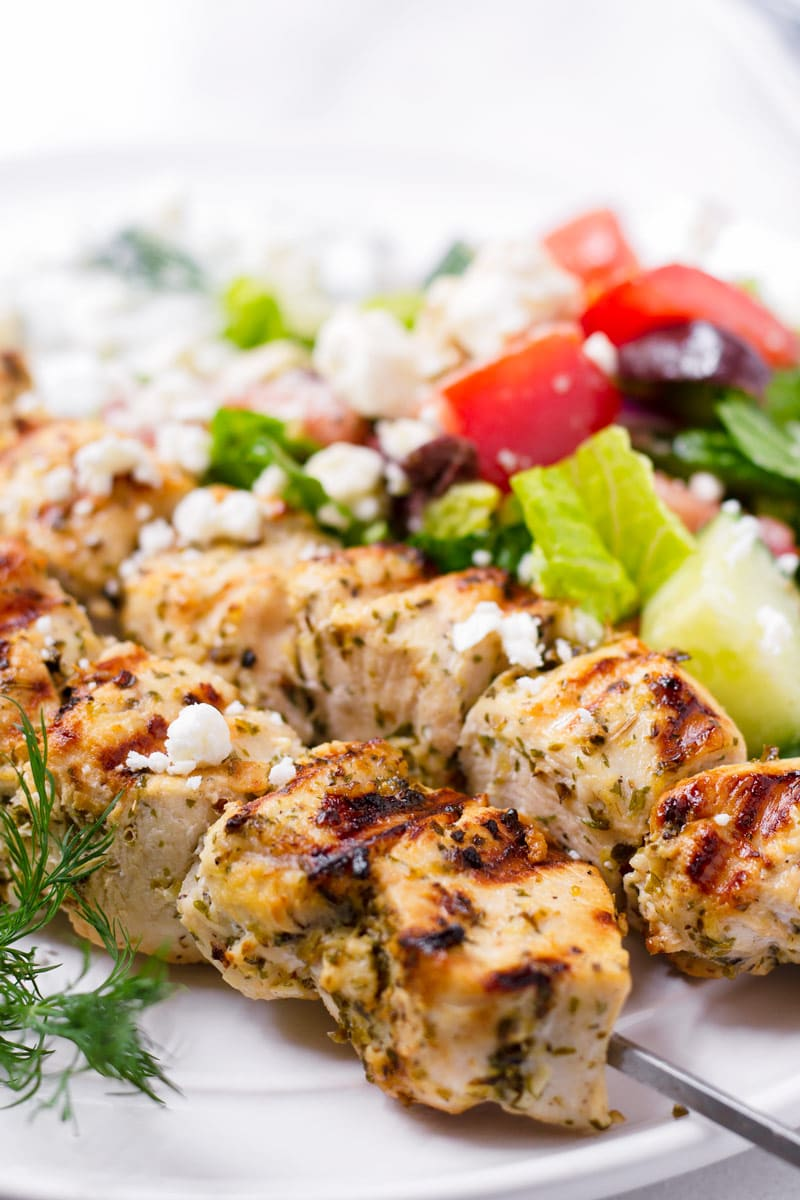side view of grilled Greek chicken kabobs