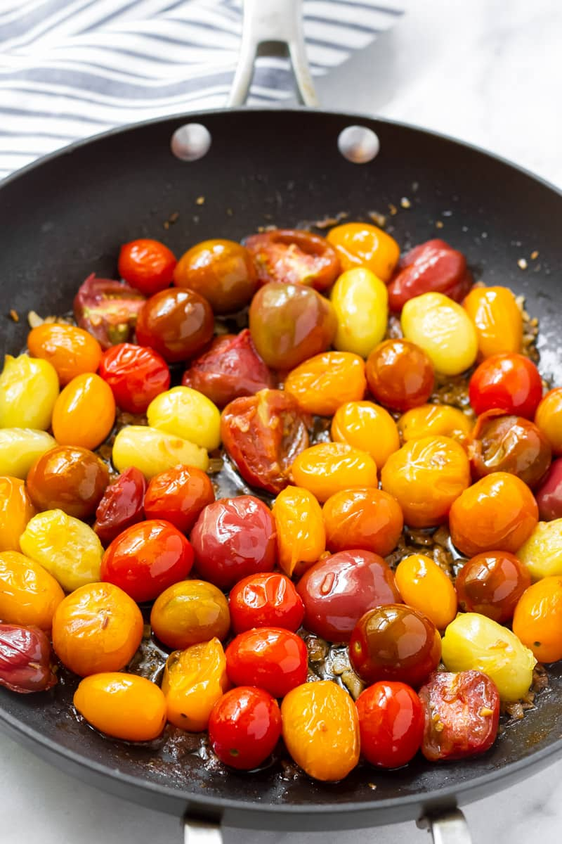 Skillet with blistered heirloom tomatoes