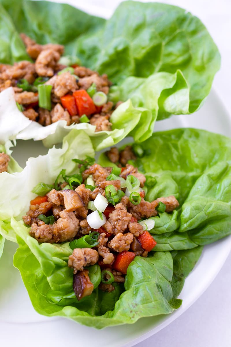 Two leaves of lettuce with Asian seasoned ground chicken filling