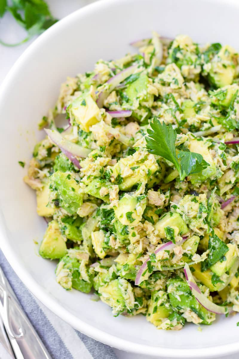 Round white bowl with avocado and tuna salad