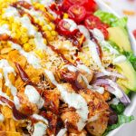 close up of chopped bbq chicken salad with dressing