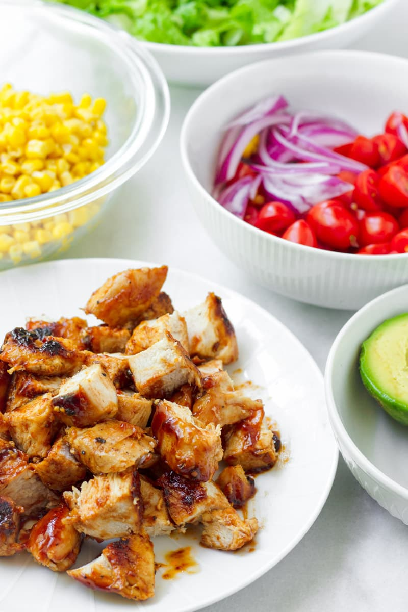grilled chicken, corn, tomatoes, lettuce, and avocado