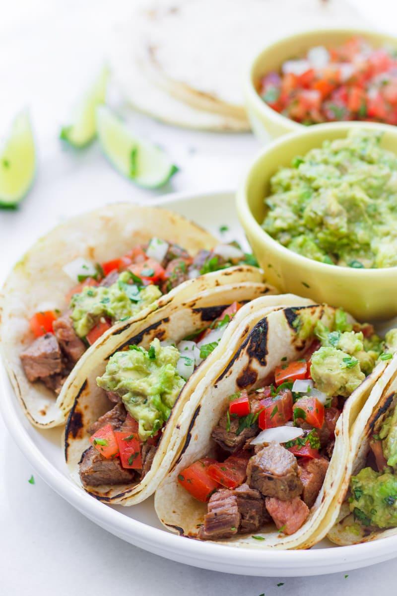 Carne asada tacos on round plate