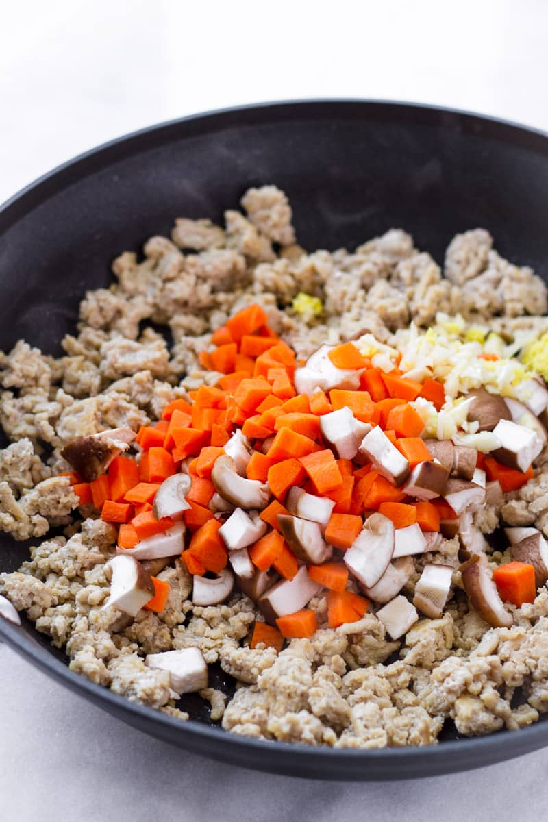 Skillet with ingredients for ground chicken filling