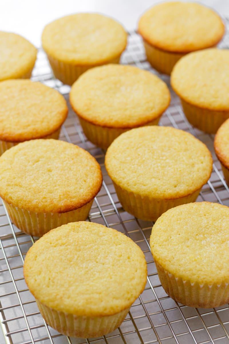Lemon cupcake base on a cooling rack