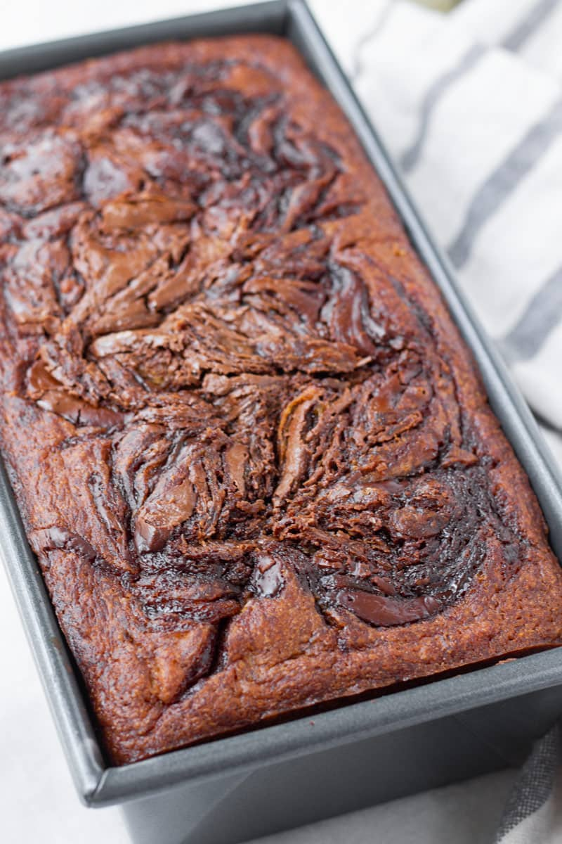 baked chocolate swirl banana bread in 9 by 5 pan