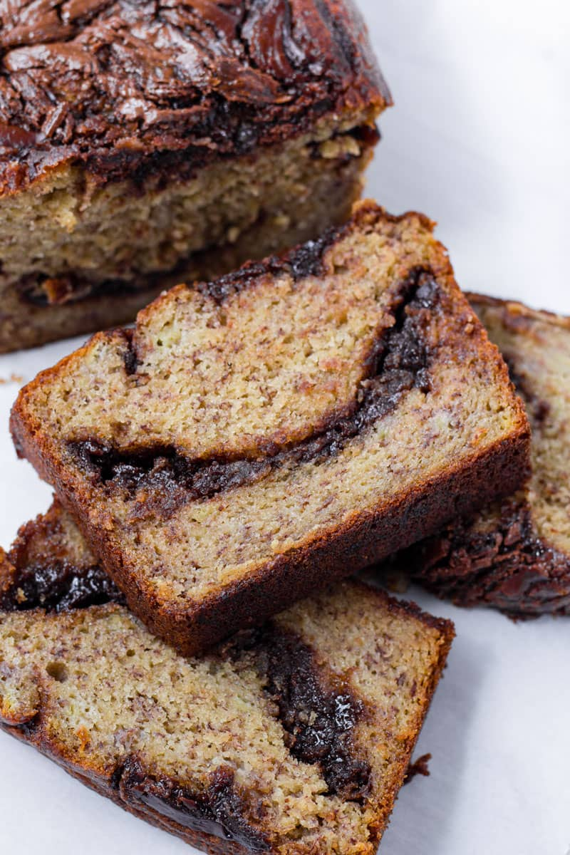 Stacked slices of baked banana quick bread with nutella