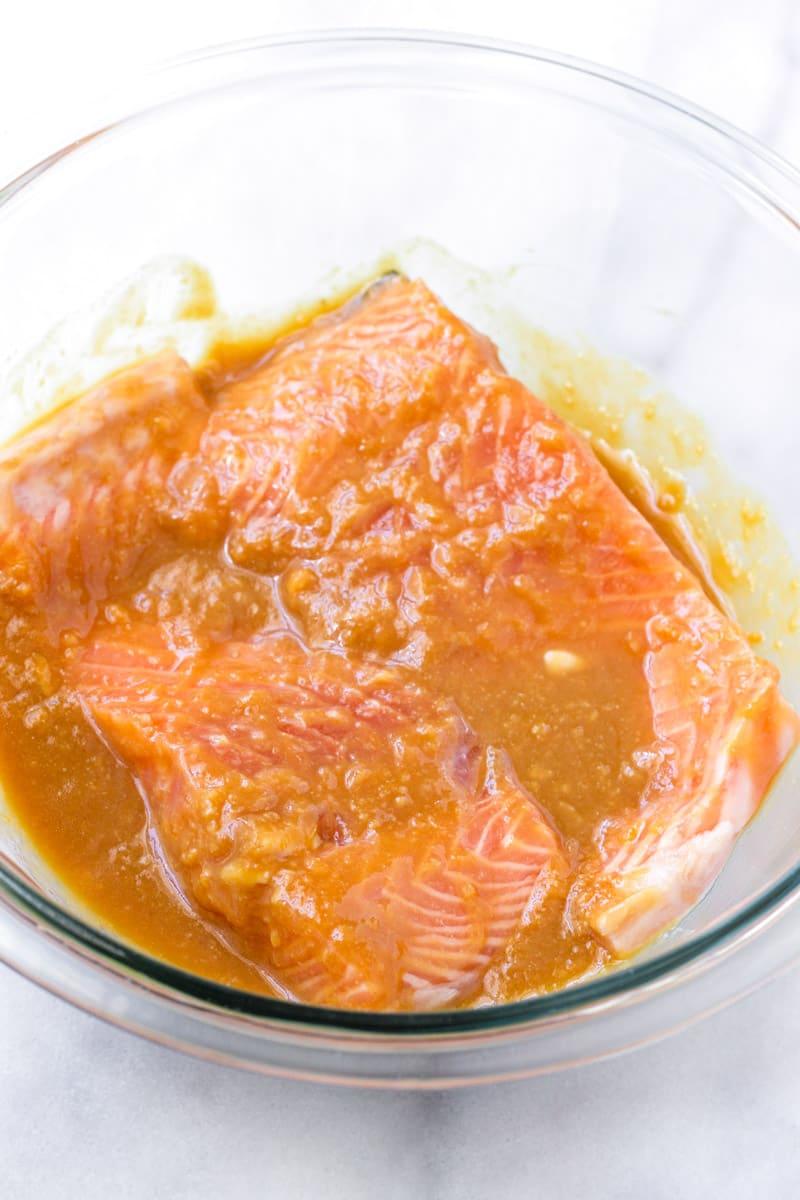 raw salmon submerged in miso marinade