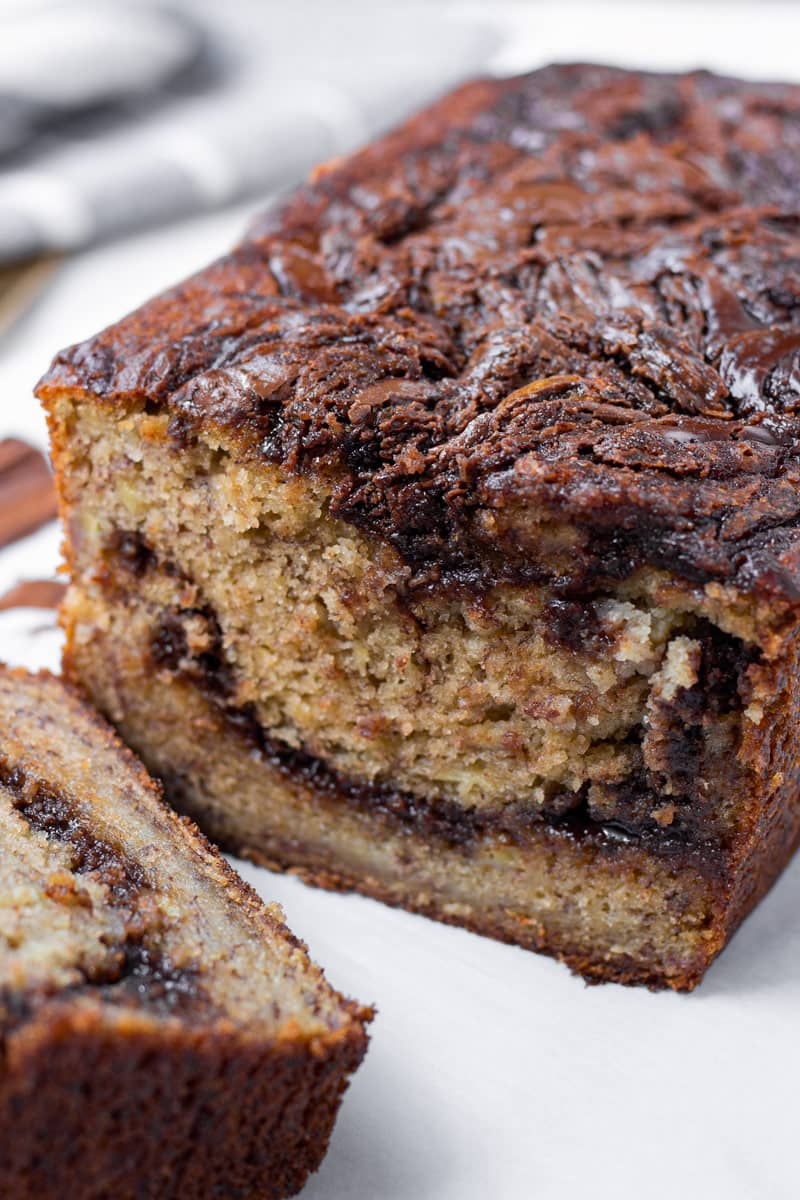 inside of a loaf of banana bread with chocolate hazelnut spread