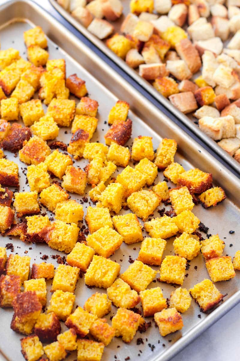 sheet pans with baked cubed bread