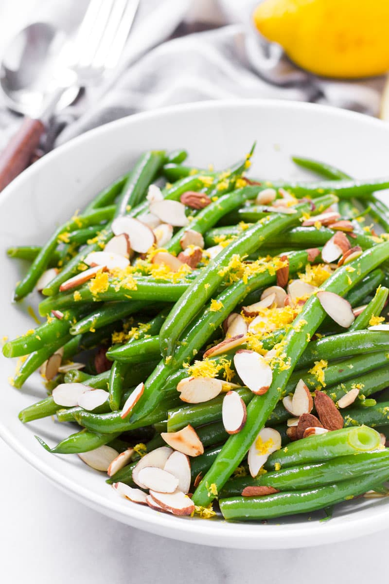 Green bean salad with lemon dressing served in a round white bowl