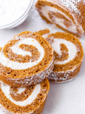 Three slices of pumpkin cake roll stacked