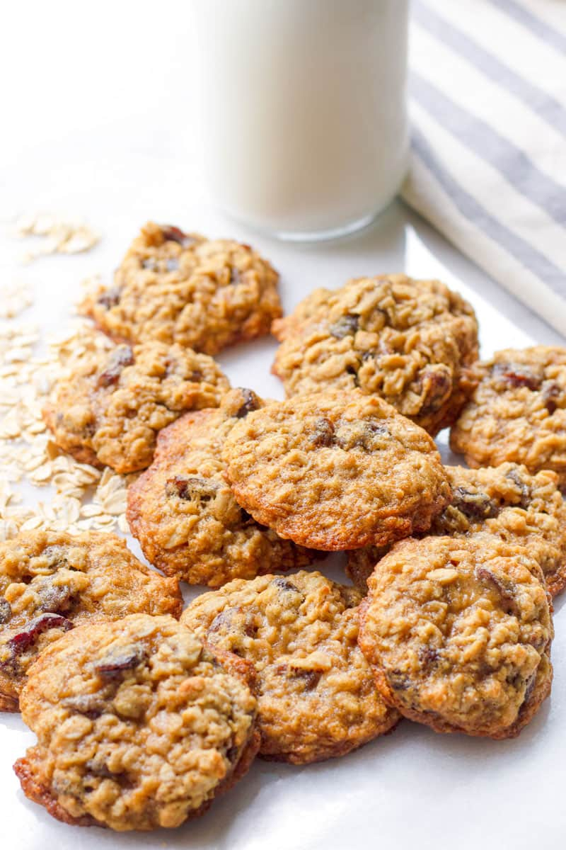 Several golden brown oatmeal raisin cookies arranged on top of each other