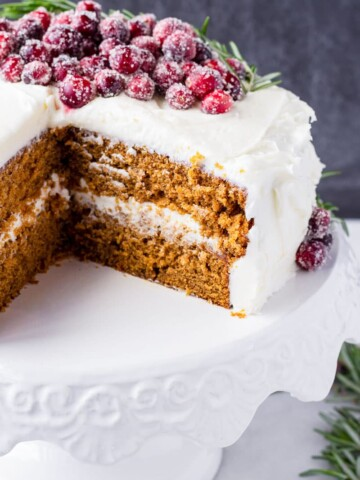 Decorated gingerbread cake on a white cake stand