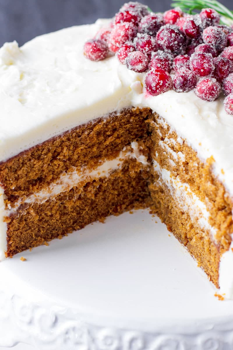 the inside of a gingerbread layer cake covered with frosting