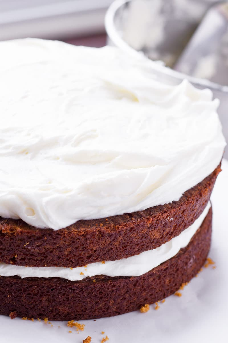 two layers of gingerbread cake with frosting in the middle and on top