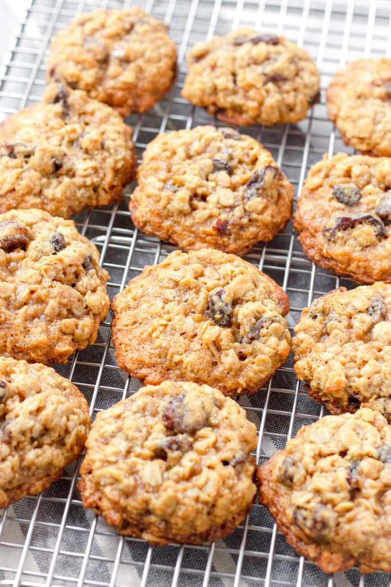 Baked chewy raisin cookies on a cooling rack