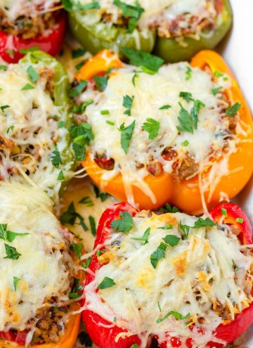 baked ground turkey stuffed peppers with melted mozzarella on top