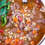 top view of hearty winter soup made with meat, grains, and vegetables
