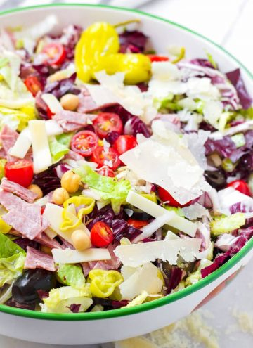 prepared salad with salami, provolone, lettuce, radiccio, olives, and cheese